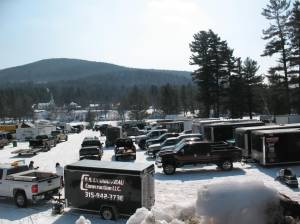 Trailers and Trucks Park on Long Lake's Field